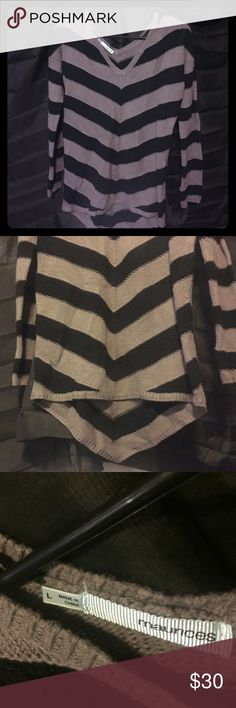 Black and grey sweater NWOT black and grey striped sweater. Kind of a high low style (shown in the 2nd pic) where the back ends in a point. Really cute and soft not the itchy sweater type. Maurices Tops