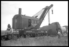 """Caption: """"NP Wrecker 43 starting to lift NP 1606 overturned I wreck of Ollie Branch train at Beach, ND""""  Date: September 6, 1930       Location: Beach, ND       Photographer: Ron V. Nixon  Railroad: Northern Pacific Railway       Station: Beach --- USA"""
