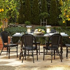 La Coupole Outdoor Dining Table, Rectangular Black Granite Top;  and Parisian Bistro Outdoor Dining Chair; both from Williams Sonoma Home.