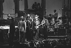 Ringo Starr, rear centre drumming with Bob Dylan and the Band, November 1976