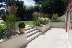 Buff Sawn Sandstone Paving is both hard-wearing and stylish. With a range of matching copings stones step treads and edgings all available off the shelf this product is extremely versatile and well suited to both traditional and contemporary schemes. Landscaping Tips, Garden Landscaping, Landscape Edging Stone, Coping Stone, Raised Patio, Garden Paving, Garden Steps, Garden Paths, Sloped Garden