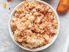 Lexington-Style Red Slaw In Lexington, North Carolina, coleslaw is made with a spicy ketchup-based dressing. This recipe first appeared in our June/July 2011 BBQ issue along with Dana Bowen's story East Vs. West.