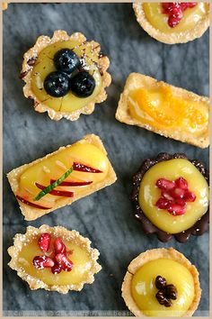 Petits Fours with Lime Cream and Dark Chocolate   Almond Crust •5 1/3 oz pastry flour •1 oz almond flour •1.5 oz confectioner's sugar •1 pinch of salt •3.5 oz butter, at room temp •1 egg; lime filling •1/2 cup lime juice •2 3/4 oz butter•2 eggs•3/4 cup fine cane sugar; garnish •1 3/4 oz dark chocolate (70% cocoa min.)•Fruits,