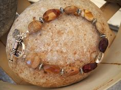 Picture Jasper Coin Beads Mookaite Twist Beads Pewter and Antique Silver Beaded Bracelet by Beads4You2008 on Etsy https://www.etsy.com/listing/232641077/picture-jasper-coin-beads-mookaite-twist
