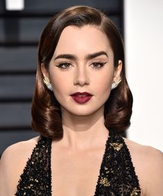Collins has been killing awards season this year and she certainly went out with a bang. We think the actress is bringing gothic beauty back in a big way.