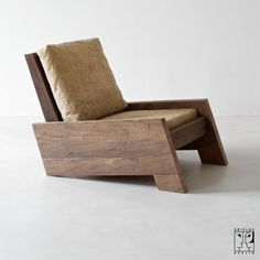 Chair by Carlos Motta, made of recycled massive wood.