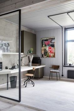 Take a look round this cosy and industrial home in Sweden! With wooden floorboards and dark painted door frames and furniture this is perfectly cosy including this workspace! #industrial #cosy #decor #workspace #office