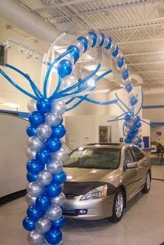 Pearl Arch with Balloon Columns using a twisting balloons on top of columns.