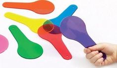 COLOR PADDLES SET: 6 different colored transparent paddles. Paddles have a hole in the handle so they can be strung together. Perfect for light table use!