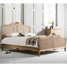 Weathered Mahogany Rattan Bed, by Frank Hudson. A stunning French wooden rattan…