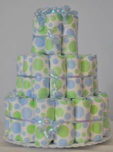 boy diaper cake instructions. Love the polka dotted diapers. Not sure which brands these are.