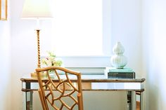 Pretty mirrored desk and bamboo chair. Discovered on search.porch.com #interiors #interiordesign #decor #mirrormirror