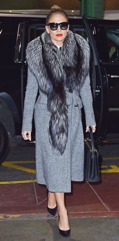 Jennifer Lopez's Most Envy-Inducing Street Style Looks - March 1, 2016: Lopez stepped out in New York City looking retro-fabulous in a gray trench and fur stole.