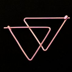 These 18 gauge Niobium Triangle Earrings are an angular interpretation of a classic hoop style! These are made from your hypo allergenic niobium,