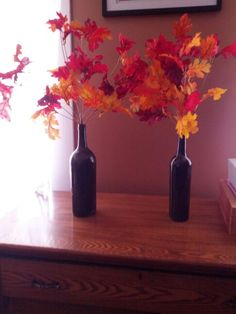 Fall decorations! Easy to do...spray paint and old wine bottle. Fake leaves from craft store