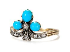 Love this ring! Victorian Turquoise & Diamond Clover Ring. Ever clever those Victorians to combine whimsy with fashion. You will be rolling in the clover with joy when wearing this 18k yellow gold and silver ring to any event. A trio of natural turquoise and ten (10) old single cut diamonds catch the light and looks of envy as a bejeweled antique clover leaf design ring. Circa 1890.