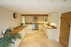 actual look of kitchen - White kitchen units, wood surfaces, spots