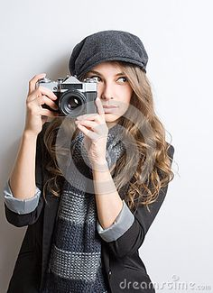 Portrait of fashionable young photo artist with vintage film camera.