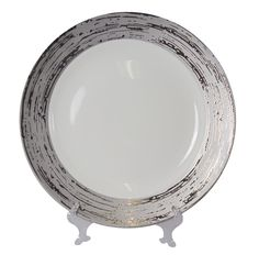 new Marais Chinaware used as a charger-we love this unique modern pattern of china