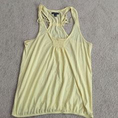 AEO Racerback Tank Perfect for spring in a pretty yellow! Has gathering at the bust, on the bottom hem, and on the back. Size medium - relaxed fit. American Eagle Outfitters Tops Tank Tops