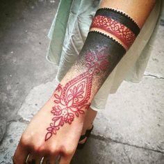 Black & Red Wrist Tattoo http://blog.tattoodo.com/2016/01/stylish-tattoos-dodie/