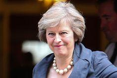 Poll predicts Tories' majority loss as UK votes