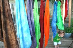 A couple months ago I came upon a tutorial on The Artful Parent for Kool-Aid Dyed Playsilks. I hadn't really heard about playsilks before that but upon further investigation found out that they're awesome. They can be pretty much anything your child wants them to be: capes, dresses, blankets, scenery, tents and the list goes on and on.