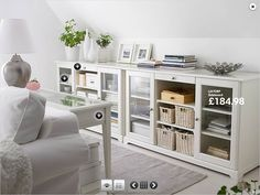 Small sitting room storage from Ikea. Need something like these for knee walls upstairs