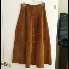 """Suede skirt  Brown suede skirt in mint condition. Fully lined.  No stains, tears, holes, etc.  measures 35"""" from waist to hem. All snaps in excellent working order.  Comes from smoke free, pet free home. Carole Little Skirts A-Line or Full"""
