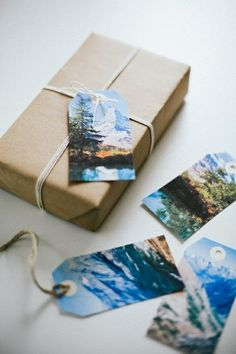 Use photos as gift tags, writing on the back. Choose relevant photos for the person receiving the gift.