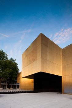 dezeen:  Shimmering brass walls surround this arts centre by Portuguese firm Pitagoras Arquitectos»