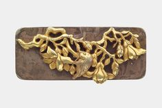 Kanamono in the form of a bird on a branch of magnolia, with backplate. Japanese Edo period–Meiji era mid to late 19th century (before 1889) http://www.mfa.org/collections/object/kanamono-in-the-form-of-a-bird-on-a-branch-of-magnolia-with-backplate-10136