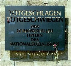 """A memorial at the Sachsenhausen concentration camp in Oranienburg, Germany.   The memorial reads: """"Deathblow, deadly silence of the homosexual victims of National Socialism."""""""
