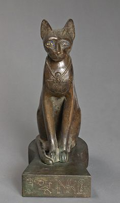 Bastet: Late Dynasty Inlaid Bronze Cat Statuette...Thousands of years ago, cats were worshiped as Gods...they have not forgotten this.