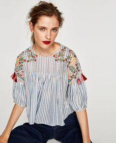 Image 2 of STRIPED EMBROIDERED TOP WITH POMPOMS from Zara