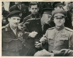 1945- Allied leaders prepare to drink a toast after USSR Marshal Dmitri Zhukov decorates British Field Marshall Bernard Montgomery with the Russian Order of Victory at Frankfurt Am Main, Germany. L-R: Field Marshall Sir Bernard Montgomery, General Dwight Eisenhower and Marshal Gregor Zhukov.