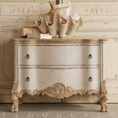 """Eloquence Roma Commode in Gold/Taupe Two-Tone From the Eloquence Collection, this commode is divine! A beautiful reproduction, made to order, """"Italianate"""" chest with ornate carvings, in a sandy beige base featuring gold leaf highlights. This commode is the perfect nightstand for your European bedroom. Enjoy the opulent style and an abundance of storage space! Also available in """"stone."""" Measures 29"""" tall by 40"""" wide by 24"""" deep."""