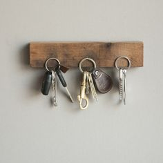 Your man will be impressed with the rugged look of this functional magnetic wood key largo ($50).