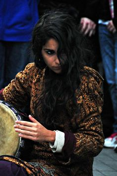 A young busker performs traditional Turkish songs in Istanbul's busy Istiklal (Independence) Street. She had a haunting voice and had passersby spellbound | Photo by ryno with Pin-It-Button on http://www.trekearth.com/gallery/Middle_East/Turkey/Marmara/Istanbul/Istanbul/photo1357202.htm