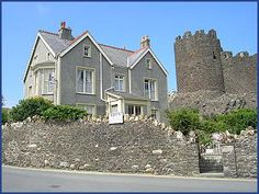 bryn guest house bed and breakfast accommodation in conwy Great Places, Places Ive Been, Medieval Tower, North Wales, House Beds, B & B, Bed And Breakfast, Towers, Lodges