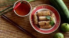 Setting chili and Spring roll set on bamboo basket background, Vietnamese food, vintage style Food concept footage