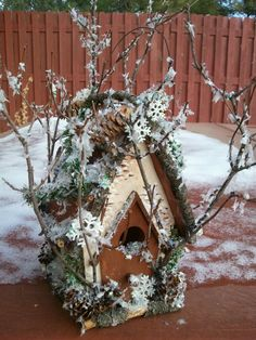 """snowy"" house with pinecones"