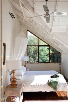 again, white and light, simple easy and I am loving the angles of the ceiling, the tiny picture window out the side... sleep peacefully in there i reckon