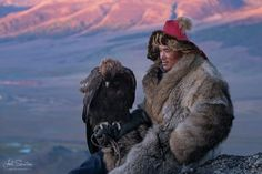 Shokhan and his golden eagle Eagle Hunter Western Mongolia.  Joel Santos - www.joelsantos.net . More at http://ift.tt/2gl6pXH