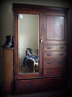Oh, I remember these old wardrobes from so long ago. Back then they were 'junk' & now they're 'antiques' :-) Wish I had one.