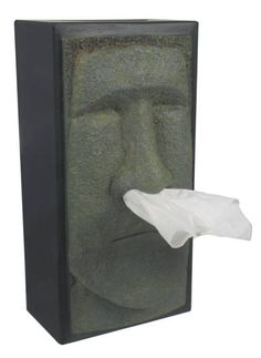 For the person who has everything, they probably don't have Rudy, the Tikihead tissue box holder!