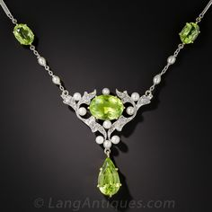 Edwardian Peridot, Diamond and Pearl Necklace. From the first or second decade of the last century, a ravishing and romantic necklace composed of four gleaming lime green peridots, the center of which is enveloped in an artful, open foliate design, expertly rendered in platinum, sparkling old mine-cut diamonds and small lustrous natural pearls. For added warmth, the peridots are set in yellow gold.