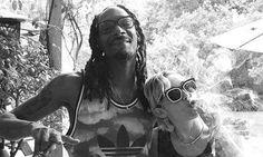Miley Cyrus and Snoop Dogg puff away on a marijuana joint
