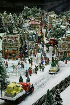 Stunning pictures of artist Richard Coyne's full-motion Christmas re-creation of three different eras. It took Richard 600 hours to bring the scenes to life. (Courtesy of Richard Coyne) Christmas Tree Village, Christmas In The City, Halloween Village, Christmas Town, Christmas Villages, Noel Christmas, Beautiful Christmas, Christmas Mantles, Christmas Scenes