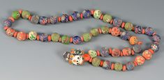 "Lot 599: Ancient Middle Eastern Glass Beads - Strand of mixed ancient Phoenician, Islamic, and Byzantine glass beads with a central pendant depicting a human face. Beads range in size from 1/8"" to 1"". Necklace measures 14 1/2"" folded. 500 BCE to 800 – 1000 AD. Provenance: the estate of Mrs. Adna Godfrey Wilde, Jr. (Sara Joan Wilde), Colorado Springs, CO. Condition: Overall very good condition with expected general wear. - See more at…"